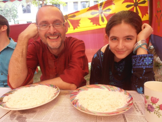Father and daughter eagerly awaiting our curry!