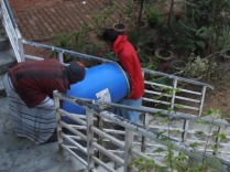 one of he barrels being hoisted away