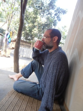 Me enjoying the view and a good hot cup of laal cha
